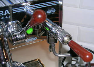 Steam toggle switch and brew activation lever